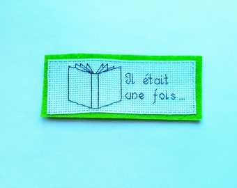 Embroidered bookmark reading it upon a time