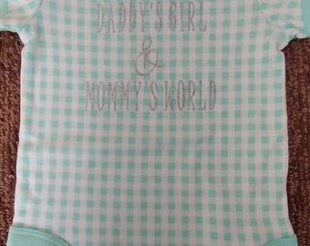 Size 12 months. Onesie. Checker pattern. Turquoise and white.