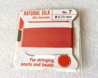Orange silk thread