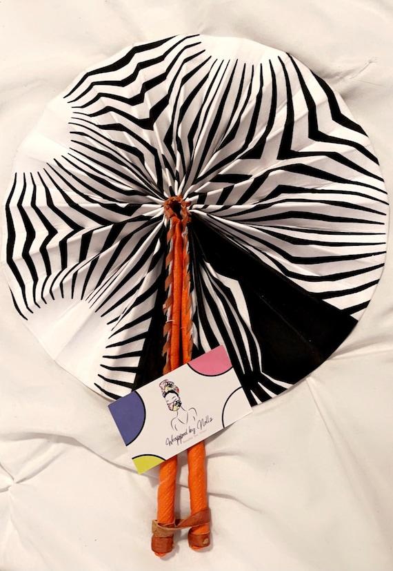 "The ""African handheld"" fan (zebra)"