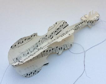 1800's music paper violins, hand cut and sewn. Paper decorations for parties, weddings, special occasions.
