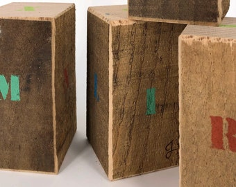 Wooden blocks. Decorated with alphabet letters in reclaimed wood