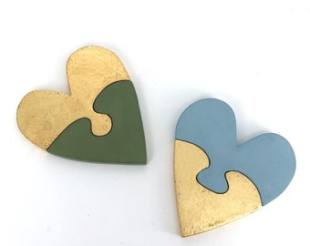 Gold leaf heart puzzles. Hand cut with a jig saw. Simple clean design. Gold leaf and tempera. Wax finish