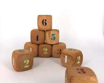 Extra large dice. Beechwood, hand painted coloured numbers. A refined natural oil finish for protection.