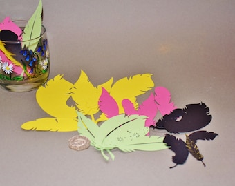 Coloured paper feathers. Feather table decoration. Crafting feathers. Feather bunting. Scrapbooking
