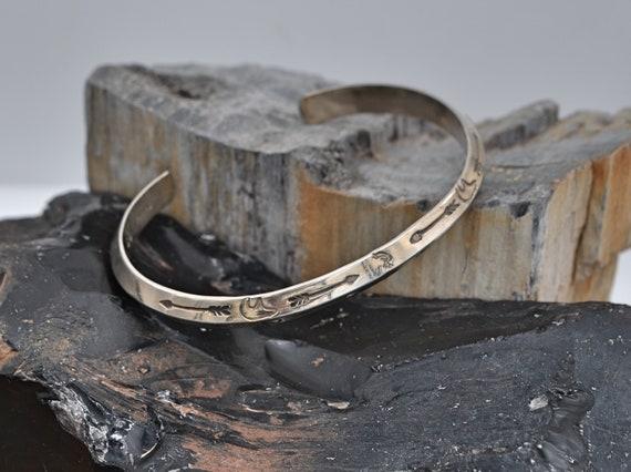 Glenn & Irene Sandoval, Vintage Native American Sterling Silver Cuff Bracelet Stamped with Arrows, Kakopelli dancer's and Bear Picto's