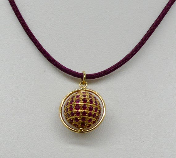 Magnificent Vintage Ruby and 14kt yellow gold globe pendant