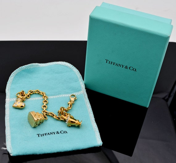 Tiffany & Co. 18k Yellow Gold Round and Oval Charm Bracelet with Tiffany Gold, Platinum Diamond Etoile Heart, Cake, Champagne Charms