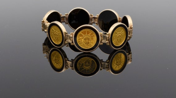 Liberty Trade Dollar Gold Coin, Onyx Ladies Bracelet from New York New York Hotel Casino Las Vegas