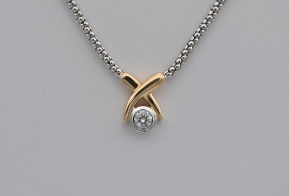 Hug & Kiss 1/4 Carat Round Briliant Cut Diamond Pendant in 14kt White and Yellow gold 18 inch Necklace