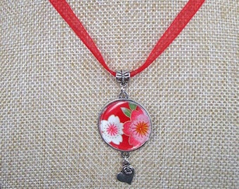 flower necklace with heart pendant