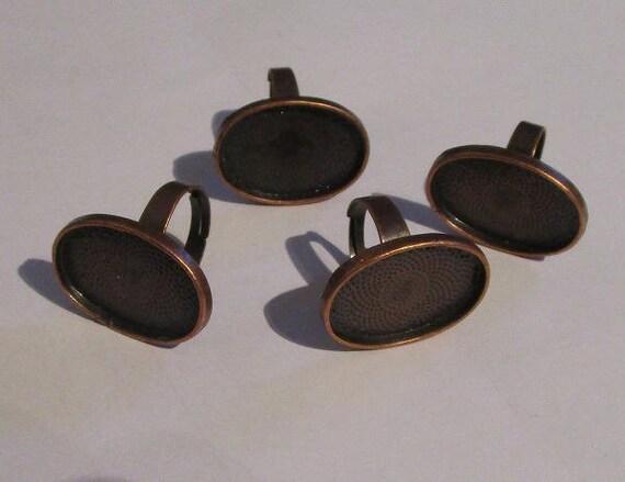 4 bagues couleur cuivrée, interieur 18x25 mm