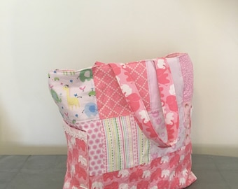 Quilted diaper bag.