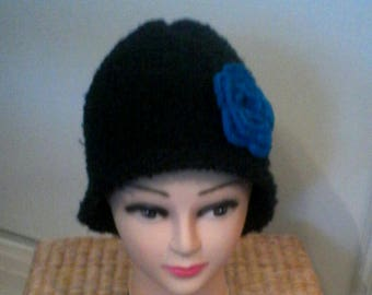 Black fashion knit hat in garter stitch with a blue crocheted flower
