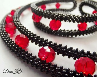 Black red set of necklace and bracelet of beads, stylish costume jewelry for a modern woman