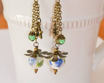 Floral dangle earrings bronze colors
