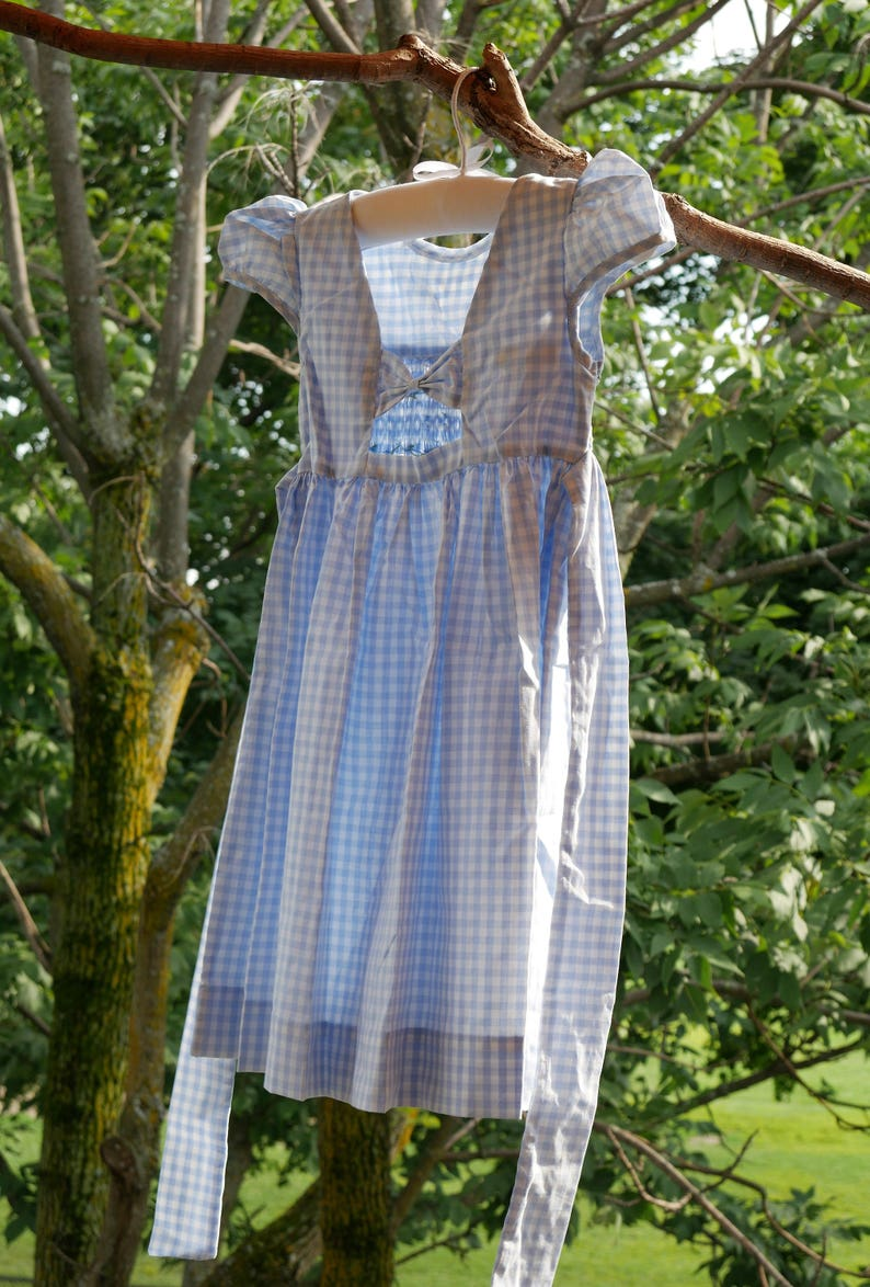 CARRIE smock dress for girl puff sleeves open V-back and with small knot. bluewhite with handmade embroidery
