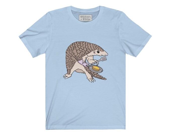 Pangolin Making Pancakes! - Pangolin Shirt - Unisex Jersey Short Sleeve Tee