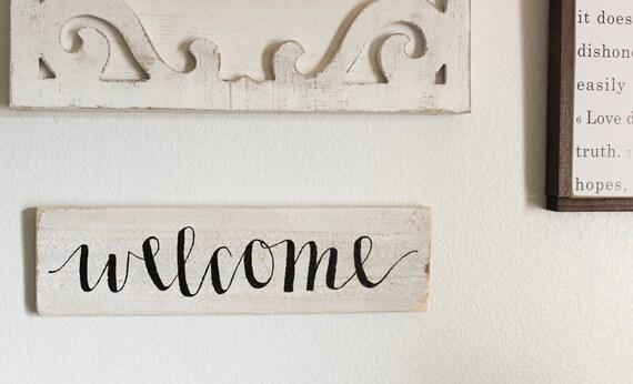 Signe de «Bienvenue» peint à la main