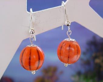 Orange pumpkin shaped earrings