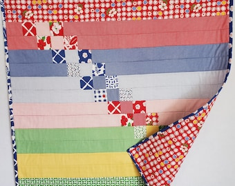 Baby Quilt, patchwork, scrappy diagonal rainbow design, Red and multi and rainbow, Moda fabric, OOAK