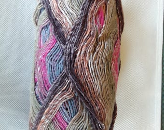 Noro Sock Yarn colored with a mix of pinks, browns with a hint of orange