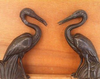 Pair of herons in metal