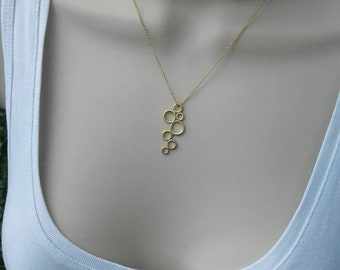 Delicate 14k gold necklace with circle pendant