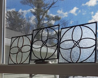 Small Clear Spirograph Flower Stained Glass Panels are perfect for a modern accent to any home. They look great by themselves or as a trio!