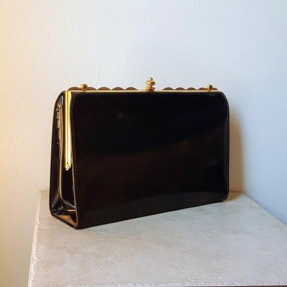 gold-tone corners 1950s black patent PVC clutch bag vinyl