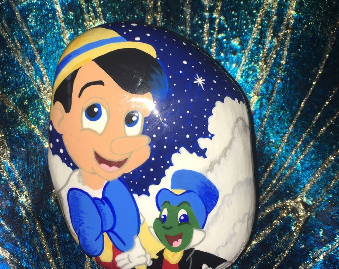 Painted rocks, hand painted rocks, gifts under 50, Disney decor, Disney rocks, Pinocchio, pinocchio and Jiminy the cricket, rock art