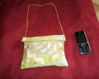 clutch made of thick fabric beige/caramel/green/blue color