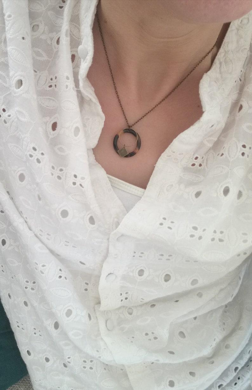 Necklace end ring speckled