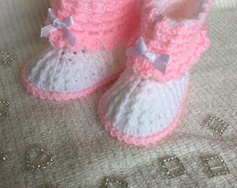 White and pink booties