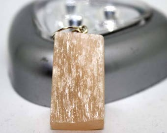 Orange yellow Calcite gemstone pendant