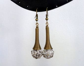 Long silver metal beaded earrings and bronze tapered cap