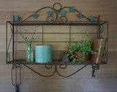 Collapsible Metal Potting Shed Shelf or Plant Stand with Faded Green Leaf Detail