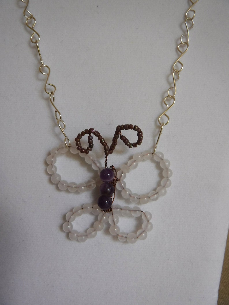 Snow Quartz and Amethyst Butterfly Pendant on Silver Plate image 0