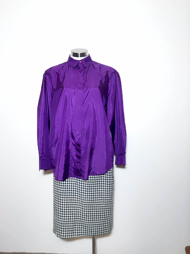 Bright purple over size shirt blouse would fit a size 12 18. Made by a south african designer adele dallas orr