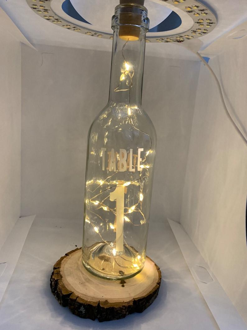 Wedding centerpiece table number lighted bottle