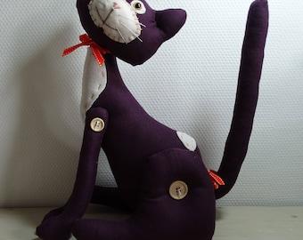 Plum colored sitting cat