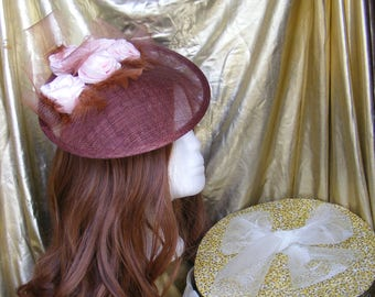 Brown sinamay hat with pink flowers