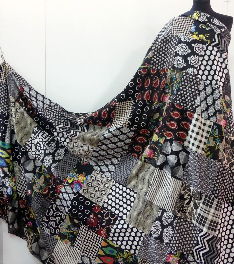 PATCHWORK AKKA in cotton black and white wihmulticolored sold by the meter