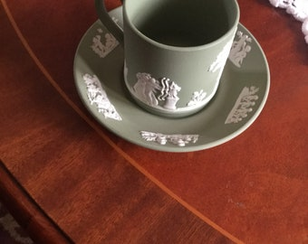 Green Wedgwood coffee cup and saucer set.