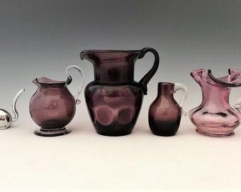 Collection of 4 Purple Art Glass Pitchers - Kanawha/Pilgrim/Rainbow Glass - Amethyst Blown Glass Pitchers