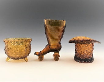 Collection of 3 Amber Glass Toothpick Holders - Salt Cellars - Gypsy Pot - Roller Skate - Top Hat