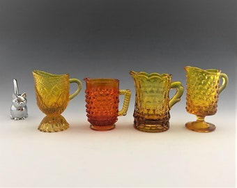 Collection of 4 Small Glass Creamers - Individual Cream Pitchers - Hobnail - Thumbprint - Amberina - Amber Glass