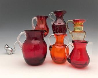 Collection of 6 Red/Orange Art Glass Pitchers - Kanawha/Pilgrim/Rainbow Glass - Red and Orange Blown Glass Pitchers