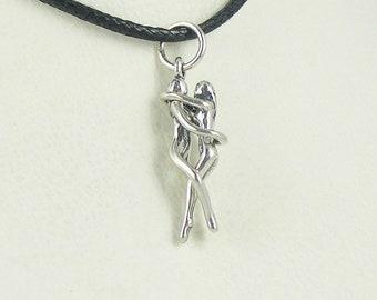 4a2e7b3d69 Woman/Woman Embrace Puzzle Pendant-Sterling Silver