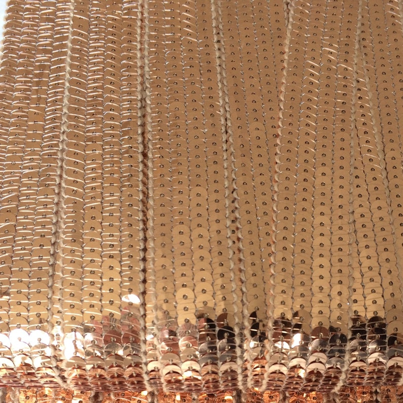 sold to the cut in multiples of 20cm BRONZE SEquins 6 rows of round sequins in 3cm wide